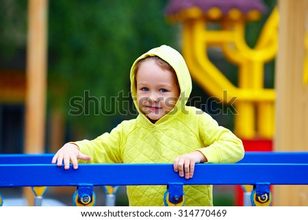 happy excited boy having fun on attraction playground - stock photo