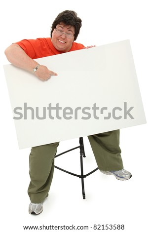 Happy excited forty-five year old obese woman with blank sign over white background with clipping path.