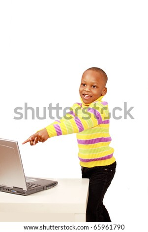 Happy excited kid pointing to computer - stock photo