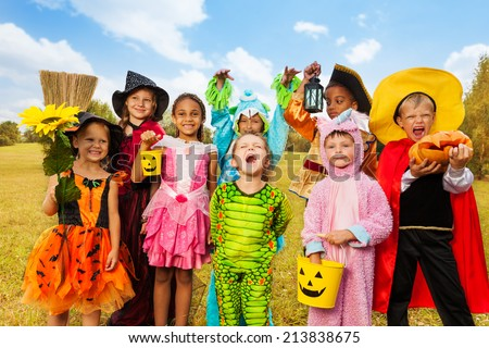 Happy excited kids in Halloween costumes - stock photo