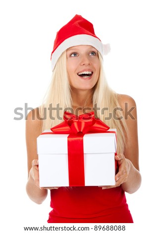 happy excited smile santa girl hold gift box, woman wear red christmas hat looking up to empty copy space, isolated over white background - stock photo