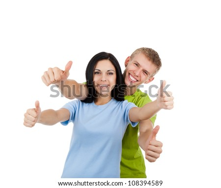 Happy excited smiling friends man and woman holding thumb up gesture, young people students girl guy standing point finger hands at you together isolated on white background
