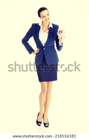 Happy excited success business woman with her piggy bank, isolated on white background. - stock photo