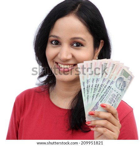 happy excited successful young woman holding Indian rupee bills