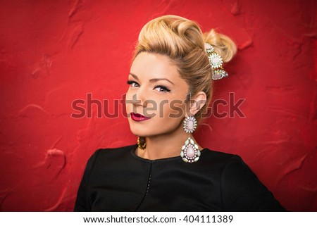 Happy excited woman looking to the side screaming cheerful with wind in the hair on red background. Beautiful multiracial Asian Caucasian female model. - stock photo