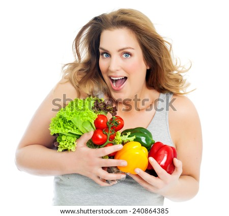 Happy excited woman with fresh vegetables over white background. Healthy eating. Real body. Beautiful plus-size model.