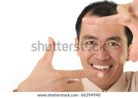 Happy executive frame target with hand, closeup portrait with copyspace on white. - stock photo