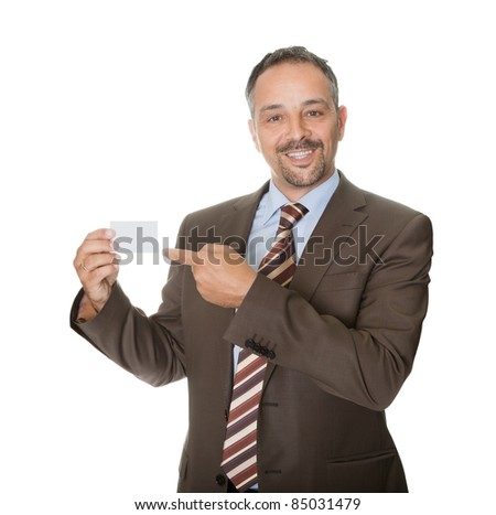 Happy executive showing a blank business card