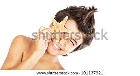 Happy face cute boy with starfish, closeup portrait of preteen brunette child, male kid model having fun, isolated on white background, summer travel and beach vacation - stock photo