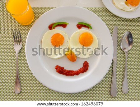 Happy Face Frying Eggs breakfast. - stock photo