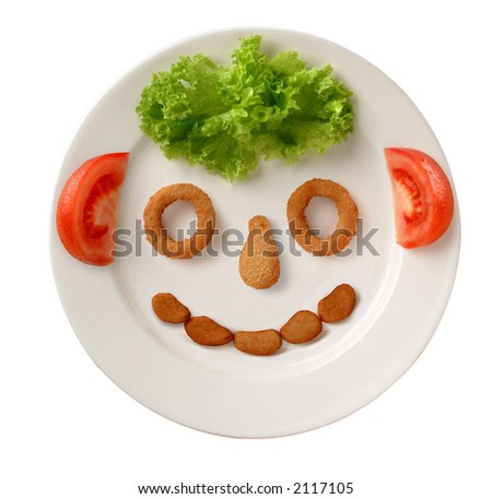 happy face made up from lettuce, tomato and breaded poultry