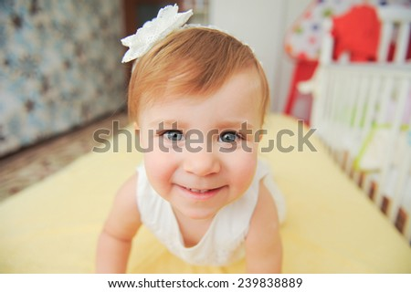 happy face on pretty girl in bed - stock photo