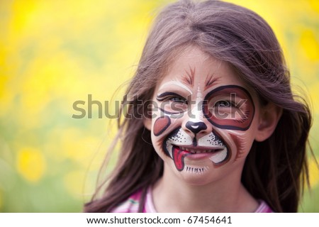 happy face painted girl - stock photo