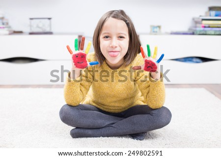 happy face, painted hand - smile and sad  - stock photo