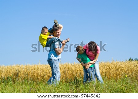 happy famaly at the nature in summer - stock photo