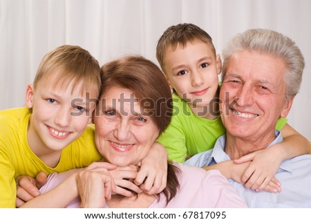 happy famaly of four on a white background