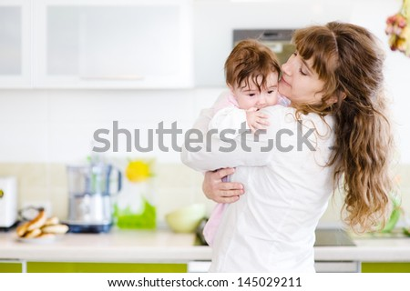 Happy family. A young mother and baby - stock photo