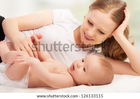 Happy family.  A young mother and  baby rests - stock photo
