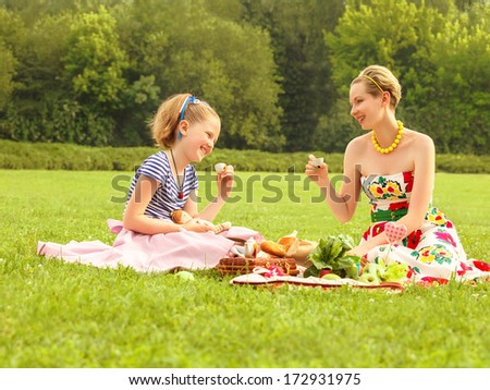 Happy family. A young mother and girl playing