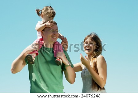 Happy family against the sky - stock photo