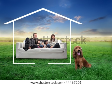 happy family and dog in the countryside dreaming a home - stock photo