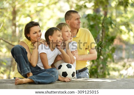 Happy family and socker ball - stock photo