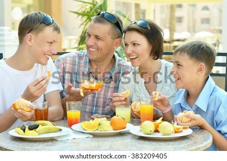 Happy family at breakfast - stock photo