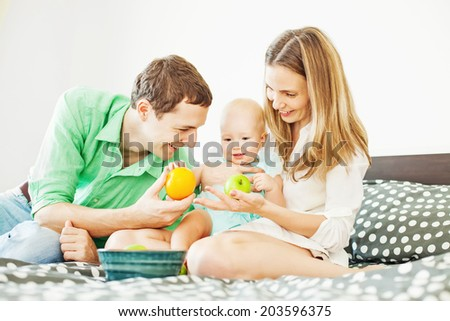 Happy family at home - stock photo