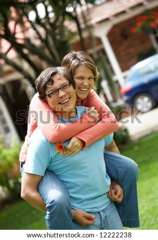 happy family at home outdoors - togetherness concept - stock photo