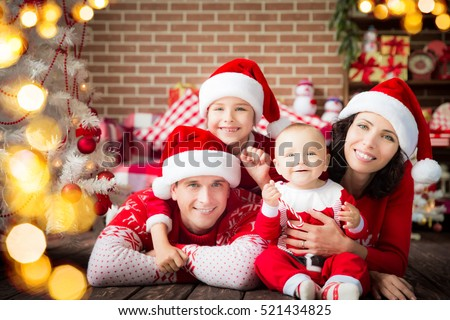 Happy family at home. People having fun together. Christmas Xmas winter holiday concept