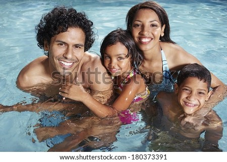Happy family at pool