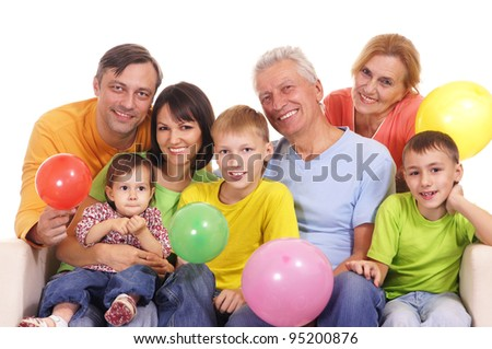 happy family at sofa sitting with baloons - stock photo