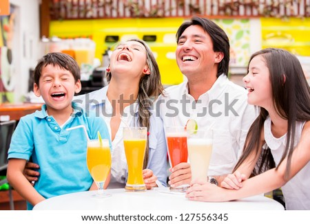 Happy family at the diner enjoying together and laughing - stock photo