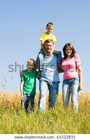 happy family at the nature in summer