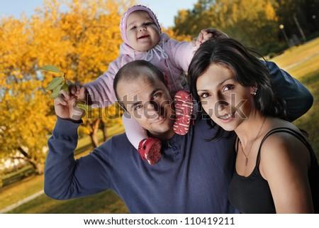 happy family  autumn outdoors - stock photo