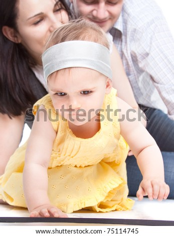 Happy family. Baby is a running a way from its parents - stock photo
