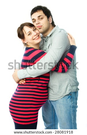 happy family, beautiful young pregnant woman and her husband embracing - stock photo