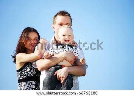 happy family blue sky - stock photo
