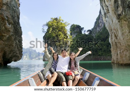 Happy family boat trip on summer vacation in Ratchaprapha Dam, Khao Sok National Park, Surat Thani Province, Thailand ( Guilin of Thailand )  - stock photo