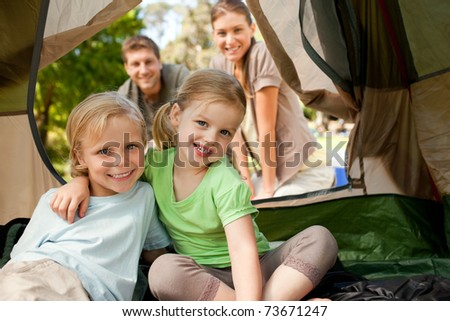 Happy family camping in the park - stock photo