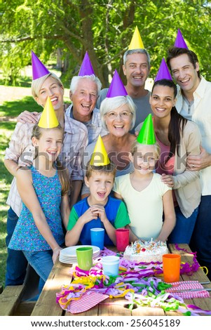 Happy family celebrating a birthday on a sunny day - stock photo