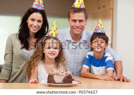 Happy family celebrating birthday together - stock photo