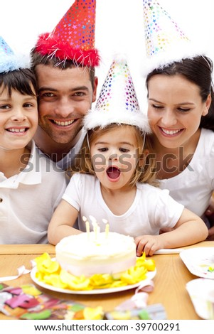 Happy family celebrating doughter's birthday - stock photo