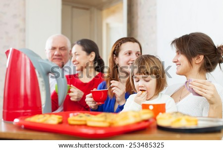 happy  family communicate over tea with cakes
