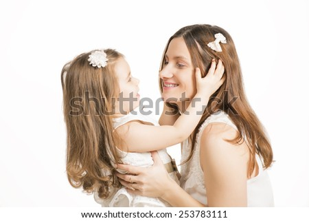 Happy family concept. Mother and her little lovely daughter, concept of togetherness, studio shot. Beautiful mother holding her little girl on white background - stock photo