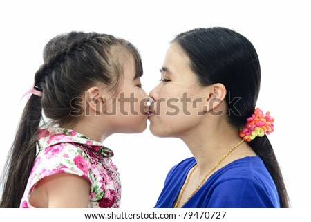 Happy family Daughter kissing Mom. Isolated on white background . - stock photo