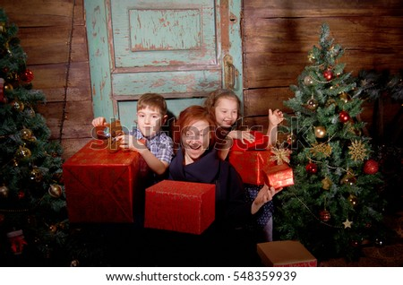 Happy family  decorate Christmas tree in beautiful living room with traditional fire place.