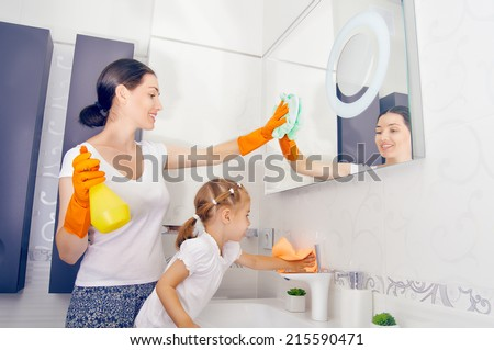 happy family do the cleaning - stock photo