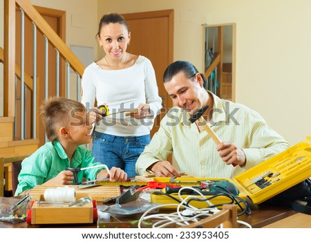 Happy family doing something with the working tools  - stock photo