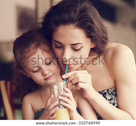Happy family drinking orange juice and joying together in urban cafe. Closeup natural emotion vintage portrait - stock photo